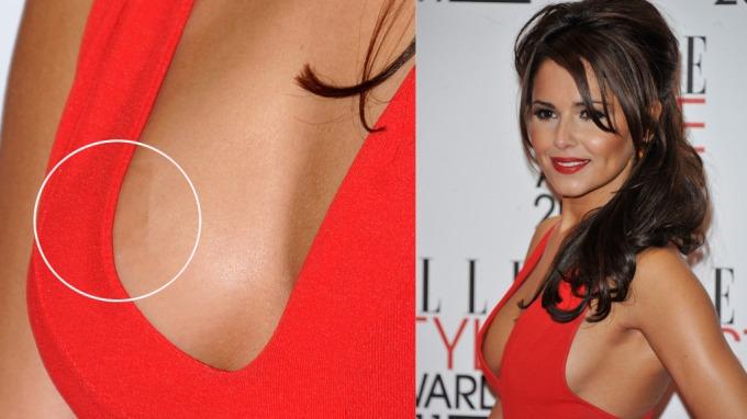 Cheryl Cole gjorde alt hun kunne for å skjule puppen på den røde løperen! thumbnail