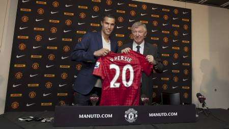 Robin van Persie, left, poses for pictures alongside manager Sir Alex Ferguson