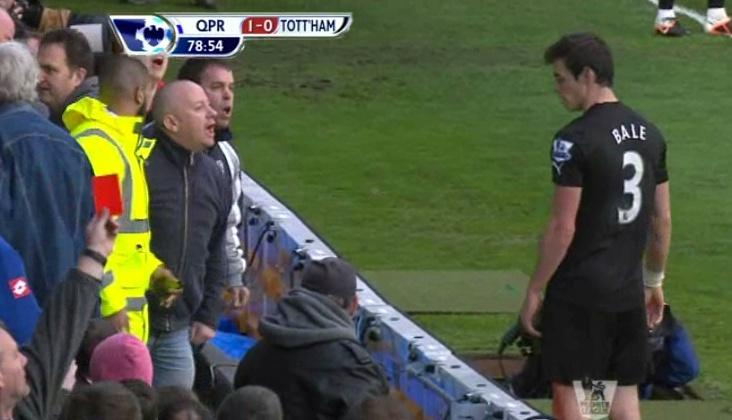 Do It Yourself: Gareth Bale (Tottenham) jumps into the angry QPR crowd to get the ball back